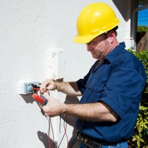 Electrician Measures Voltage